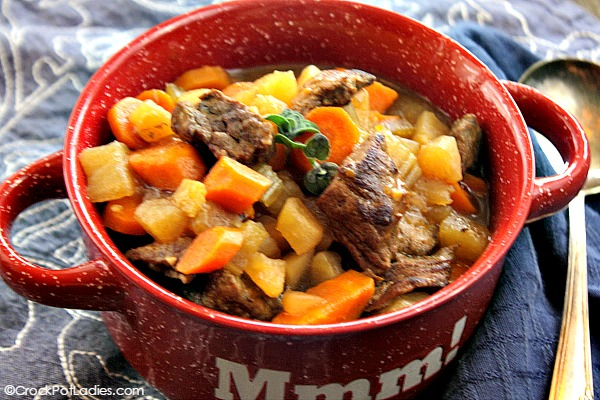 Crock-Pot Beef Stew - Warm up to a bowl of hearty Crock-Pot Beef Stew. Tender beef is simmered away in the slow cooker with carrots, onions, celery in a full of flavor stew. [recipe from CrockPotLadies.com]