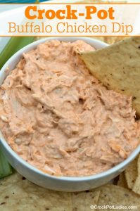 Crock-Pot Buffalo Chicken Dip - A great recipe for your next game day or party, this spicy Crock-Pot Buffalo Chicken Dip has all the flavors of hot wings and tastes great with chips or celery sticks! via CrockPotLadies.com
