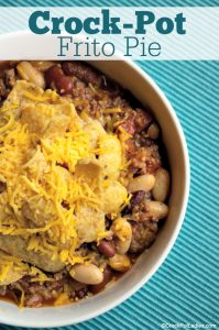 "Crock-Pot Frito Pie - Some folks call this dish ""walking tacos"" but we simply call it Crock-Pot Frito Pie. Crunchy Frito corn chips are topped with an easy homemade chili. YUM! [Low Fat, High Fiber, Low Sugar and just 9 Weight Watchers SmartPoints per serving] 