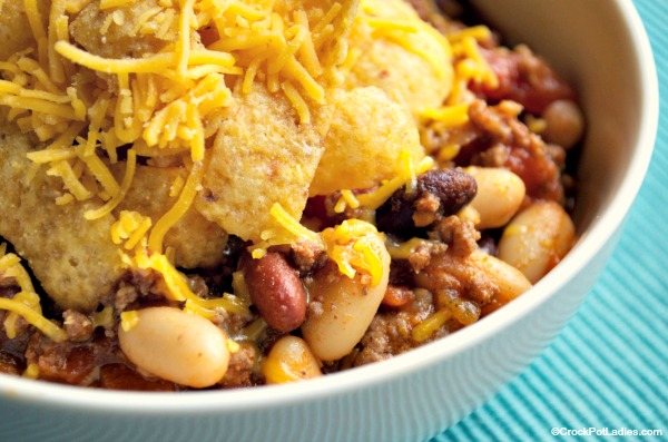 """Crock-Pot Frito Pie - Some folks call this dish """"walking tacos"""" but we simply call it Crock-Pot Frito Pie. Crunchy Frito corn chips are topped with an easy homemade chili. YUM! [Low Fat, High Fiber, Low Sugar and just 9 Weight Watchers SmartPoints per serving] 