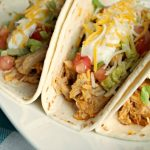 Crock-Pot Buffalo Chicken Tacos - Just 3 simple ingredients and you have the fixings for these Crock-Pot Buffalo Chicken Tacos! If you love buffalo chicken wings you will ADORE these tacos! [Healthy, Gluten Free, Low Calorie, Low Carb, Low Fat, Low Sugar & just 4 Weight Watchers SmartPoints per serving!] | CrockPotLadies.com