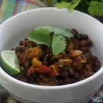 Crock-Pot Black Bean, Chorizo & Butternut Squash Chili - This simple recipe for Crock-Pot Black Bean, Chorizo and Butternut Squash Chili will fill your kitchen with mouthwatering aroma as it simmers in the slow cooker all day. Serve with cheese, and a squeeze of fresh lime juice for a hearty dinner! | CrockPotLadies.com
