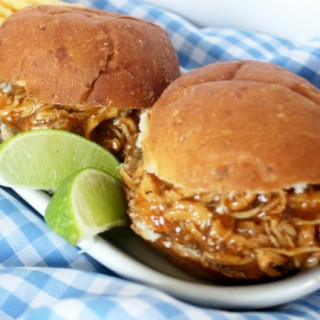 Crock-Pot Barbecue Lime Chicken - Sweet yet zesty this mouthwatering Crock-Pot Barbecue Lime Chicken will have you coming back for more. Chicken breasts or thighs are slow cooked for hours in your favorite BBQ sauce with the addition of fresh lime zest and juice! | CrockPotLadies.com