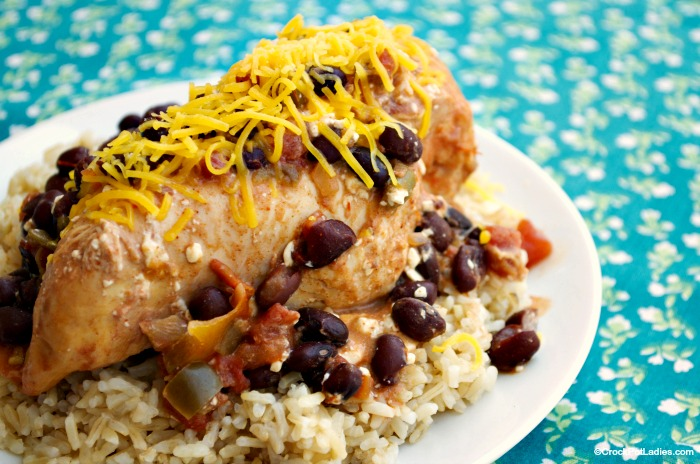 "Crock-Pot Taco Chicken - This recipe for Crock-Pot Taco Chicken is truly a ""fix it and forget it"" recipe. Chicken breasts are placed in the slow cooker and then salsa, canned tomatoes, black beans and cream cheese are all dumped on top and everything is allowed to cook until the chicken in moist and tender! This recipe is gluten free, high fiber, low sugar and just 6 Weight Watchers SmartPoints per serving! [via CrockPotLadies.com] #crockpot #slowcooker #weightwatchers #recipes"