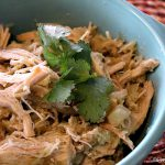 Crock-Pot Pineapple Verde Chicken - Full of flavor this recipe for Crock-Pot Pineapple Verde Chicken combines the flavors of sweet and juicy pineapple with the tang of roasted green chilies for a slow cooker chicken recipe that is out of this world. Serve the cooked chicken over nachos (like we have done here) or in burritos, tacos or a over rice and beans! (recipe from CrockPotLadies.com)