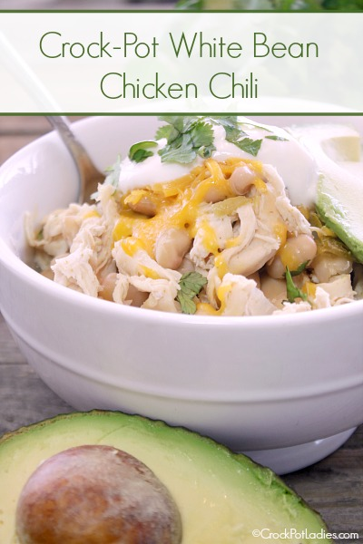Crock-Pot White Bean Chicken Chili - Nothing satisfies the pallet and the tummy like a hearty bowl of chili and this recipe for Crock-Pot White Bean Chicken Chili could not be easier to make. You just dump a few ingredients into the slow cooker and let it cook away all day. Then shred the chicken and serve with your favorite chili toppings. I love a little shredded cheese, a dollop of sour cream, a little sliced avocado and just a little cilantro on top. YUM!