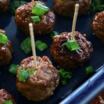 Crock-Pot Kung Pao Meatballs - Sweet and spicy Slow Cooker Kung Pao Meatballs make a great appetizer at your next party. Or double up on the sauce and serve them over rice with some steamed or stir-fried vegetables for an easy dinner everyone will love! | CrockPotLadies.com