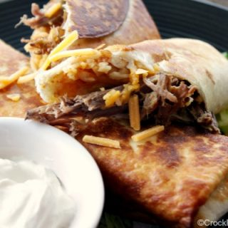 Crock-Pot Shredded Beef Chimichangas - With just a few simple ingredients you will have yummy seasoned shredded beef perfect for making homemade chimichangas either fried or baked in the oven! | CrockPotLadies.com