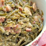 Crock-Pot Bacon and Garlic Sweet Green Beans - A perfect side dish for any meal or special occasion (think Christmas, Thanksgiving, Easter) these Crock-Pot Bacon and Garlic Sweet Green Beans will make you drool! The green beans are seasoned to perfection with bacon and garlic and then a little touch of sweetness happens with some brown sugar. Amazing! [Gluten Free, Low Calorie, Low Carb, Low Fat and just 9 Weight Watchers SmartPoints per serving!] | CrockPotLadies.com