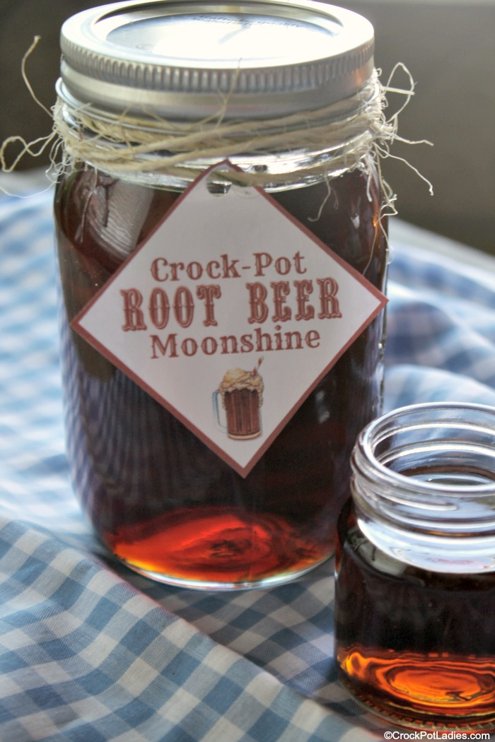 Crock-Pot Root Beer Moonshine - If you like root beer you are going LOVE this alcoholic adult beverage recipe for Crock-Pot Root Beer Moonshine! Everclear grain alcohol or vodka is sweetened and flavored with root beer extract for this perfect sipping flavored